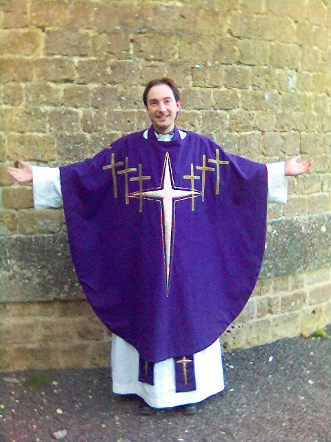 An Anglican priest wearing a chasuble over alb and stole. Author Gareth Hughes