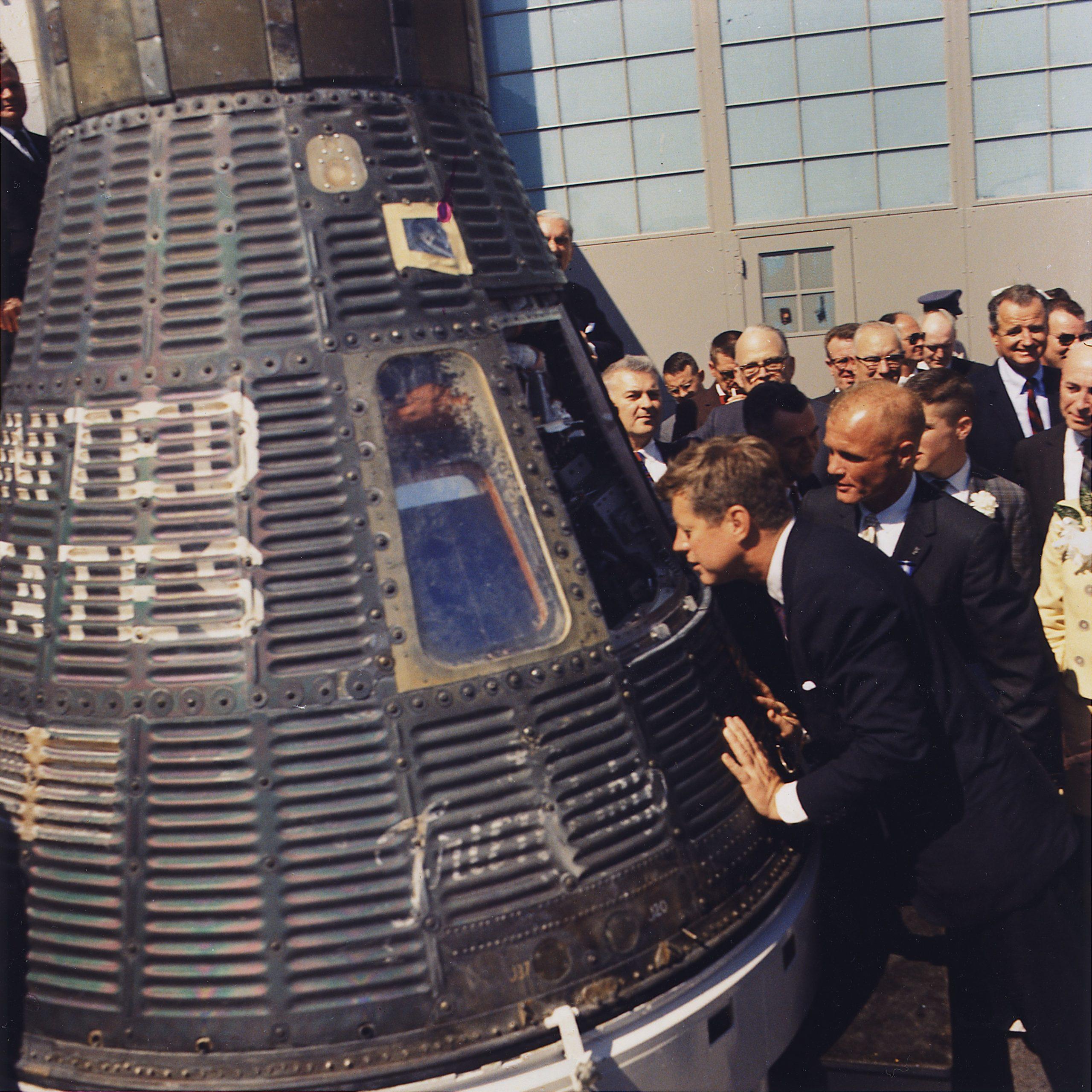 https://commons.wikimedia.org/wiki/File:JFK_inspects_Mercury_capsule,_23_February_1962.jpg