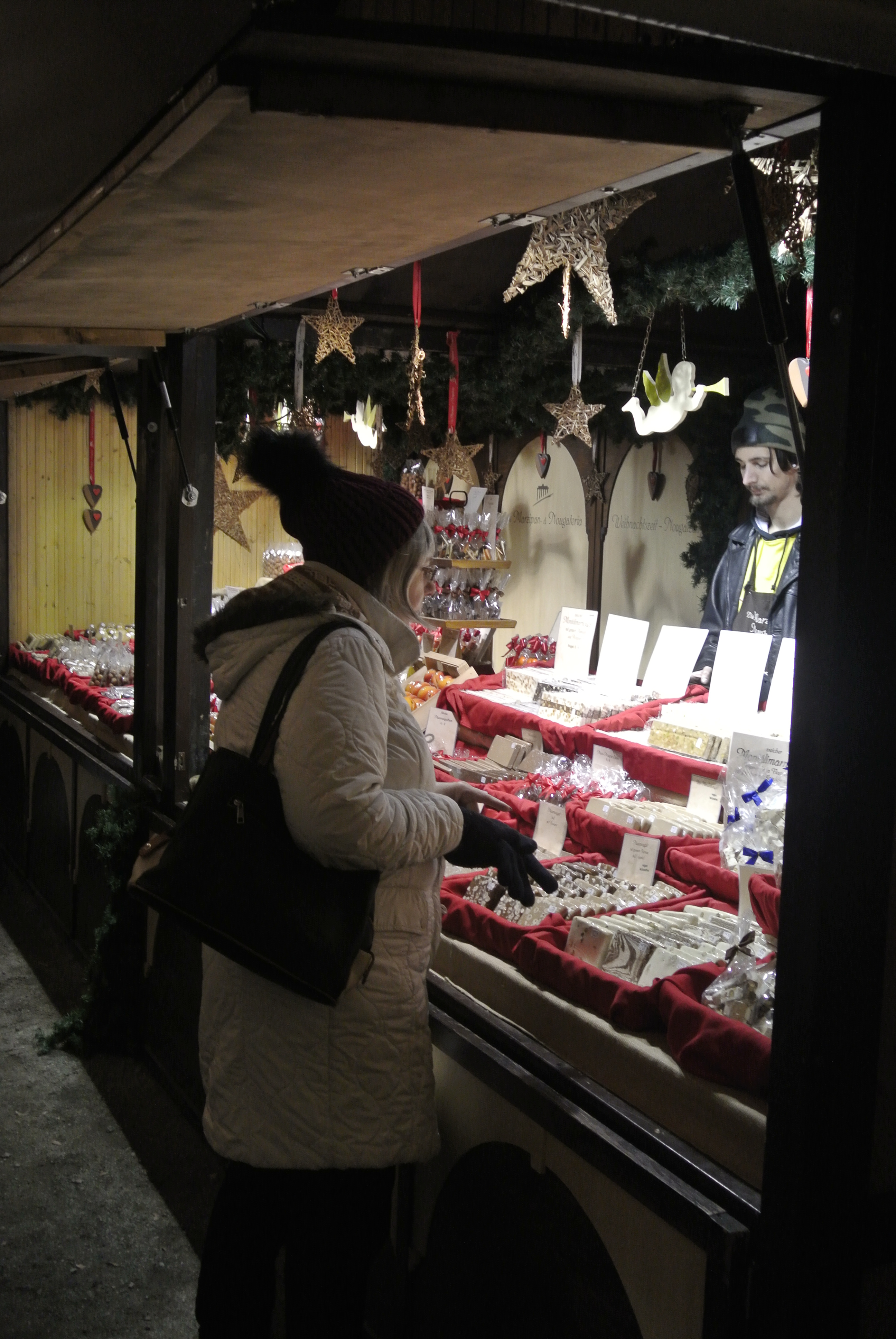 Buying sweets at a German Christmas Market - photo by Juliamaud