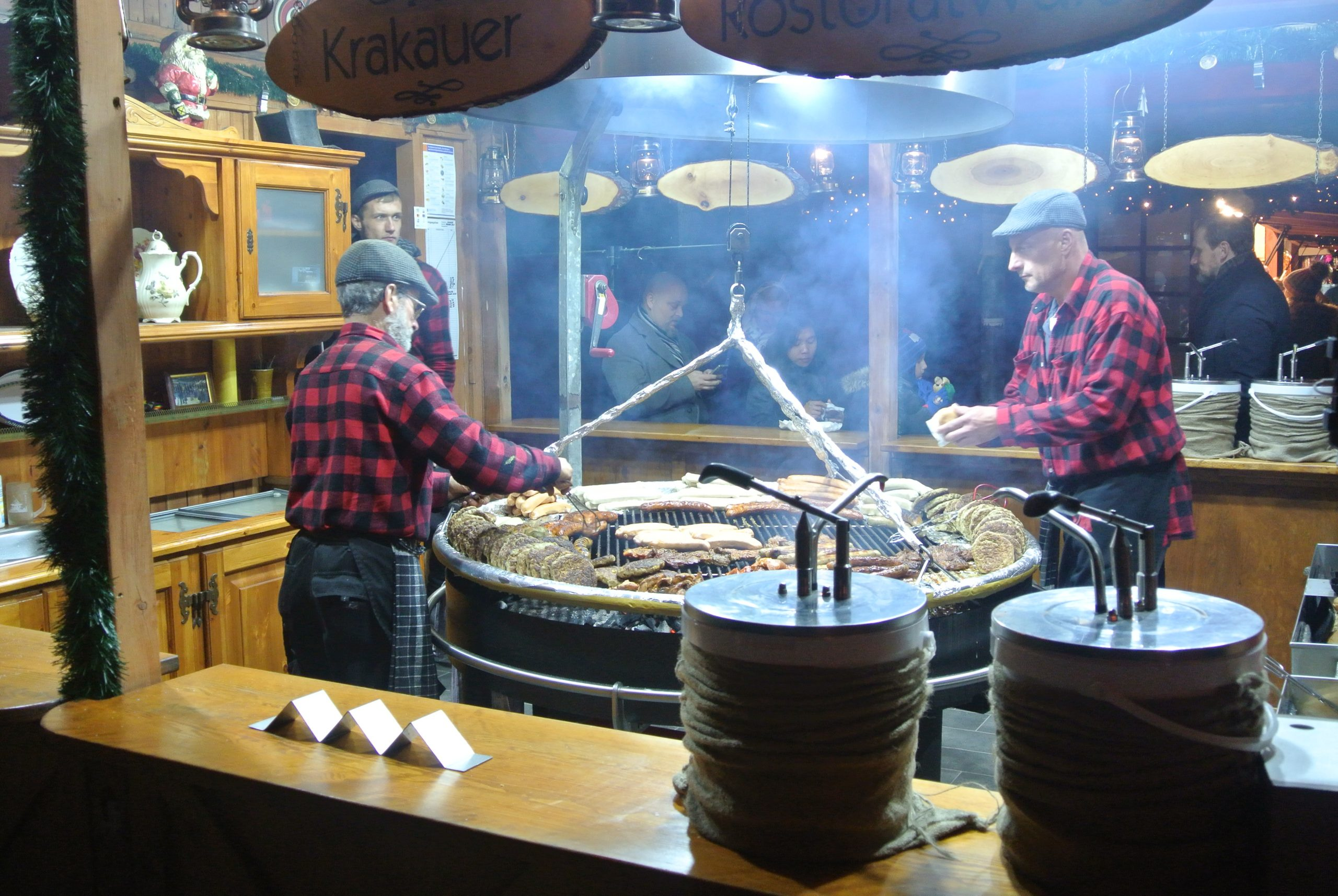 Cooking sausages at a German Christmas Market - photo by Juliamaud