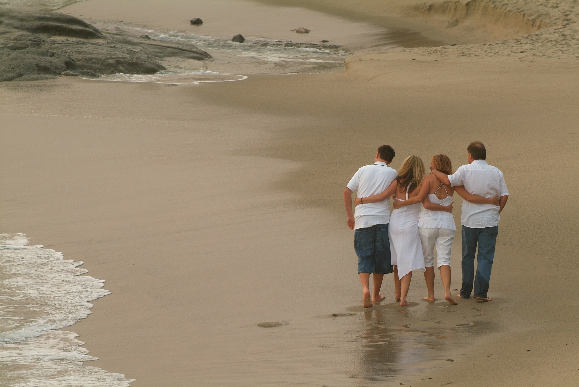 Family Vacation - photo by dave73y = https://pixabay.com/en/family-beach-surf-love-mother-216825/